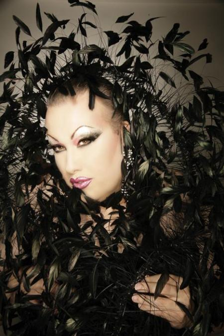 Chi Chi Larue black feathers
